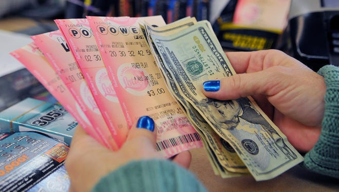 Johanne Eklund of Merritt Island buys her lucky Powerball tickets for Wednesday nights $400 million dollar jackpot that she just purchased at the K & D Discount Beverage on Merritt Island .