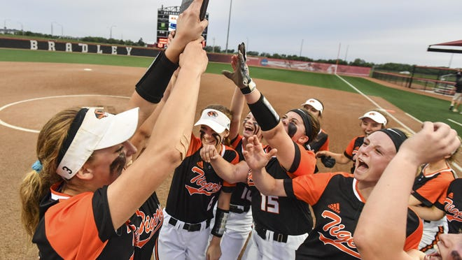 Illini Bluffs players hoist the Class 1A Sterling Supersectional trophy after their 4-2 win over Orangeville at the Louisville Slugger Complex on May 29, 2019. The facility was selected to be the host site for the state championships through 2025.