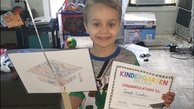 Joseph Cavallini, 6, graduated from kindergarten at Idlehurst Elementary School shortly before he died on May 30. Idlehurst staff are working on a personal flotation device program to honor him and help area children.
