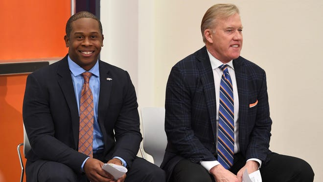 New Denver Broncos coach Vance Joseph (left) and general manager John Elway during a press conference at UCHealth Training Center.  Manning is trying to build a new Super Bowl champion.