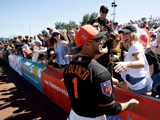 Jackie Jeffus, front right, of Santa Monica, Calif., gets an autograph from San Francisco Giants right fielder Gregor Blanco (1) before a spring baseball game against the Kansas City Royals in Scottsdale, Ariz., Friday, March 23, 2018. (AP Photo/Chris Carlson)