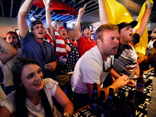 Fans at Wingin' It in Clemson watch as Belgium faces the United States in the World Cup round of 16 on Tuesday, July 1, 2014.