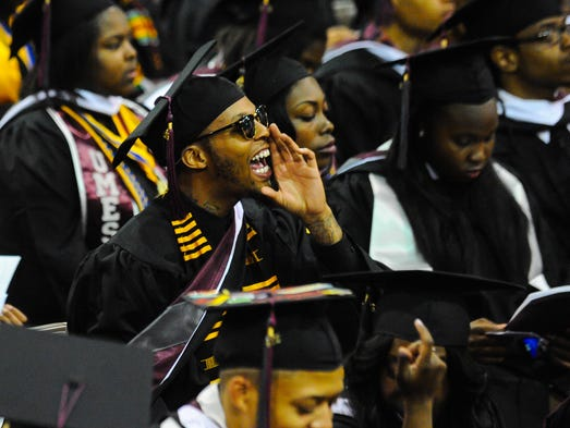 A UMES graduate cheers for student commentary by Kiera Pettus during graduation ceremonies on Friday morning at UMES.