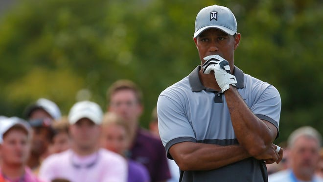 Tiger Woods waits to tee off the 16th hole during the third round of the Wyndham Championship on Aug. 22, 2015 in Greensboro, North Carolina.