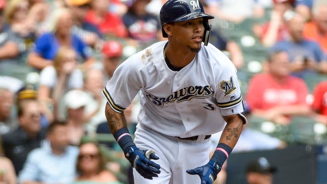 May 30, 2018; Milwaukee, WI, USA;  Milwaukee Brewers shortstop Orlando Arcia (3) drives in a run with a base hit in the seventh inning against the St. Louis Cardinals at Miller Park. Mandatory Credit: Benny Sieu-USA TODAY Sports
