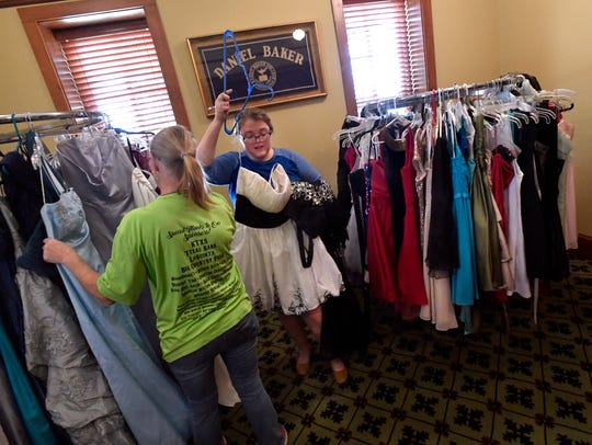 Skylare Strasser, 17, of Bangs holds a white dress as she and her grandmother, Debbie Williams, look for a prom dress March 23 at Howard Payne University in Brownwood. HPU's Social Work Club sponsors the Cinderella Project each spring, which makes slightly-used prom dresses available to high school girls at no cost.