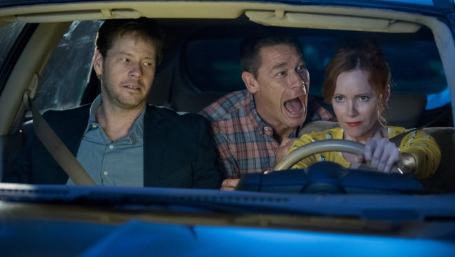 Prom night is hell for the parents (from left, Ike Barinholtz, John Cena and Leslie Mann) in the R-rated comedy 'Blockers.'
