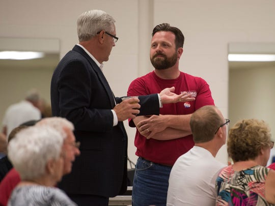 Candidates for Vanderburgh County Council district 1 James Raben, left, and David Christmas talk during the Republican election night party at the C.K Newsome Center on Tuesday, May 8, 2018.