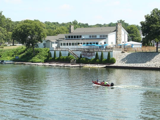 A boat passes Sportsman Inn on Lake Freeman on Aug. 10, 2016, in Montecello. Drops in water level affect residents and business that depend on the lake to be open for recreation.