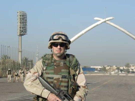 "The one time he went ""outside the wire"" during his deployment, David Abrams posed at the infamous ""crossed sabers"" or Victory Arch at Saddam Hussein's former military parade grounds. The Butte author has recently published ""Brave Deeds,"" a novel set in Baghdad."