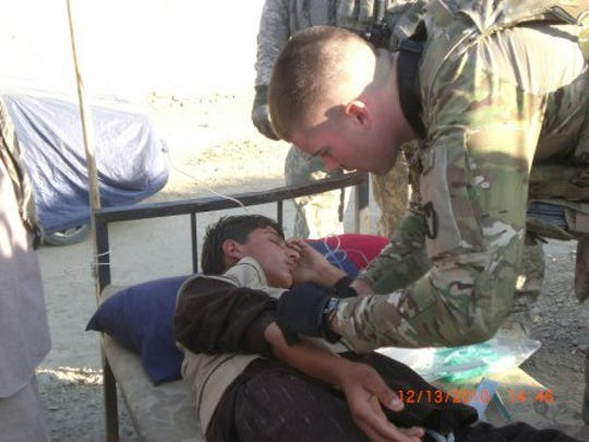 Jacob Hutchinson's duties as an Iowa National Guard medic included treating Afghan civilians. He told his mother he was most troubled by injuries he saw in children.