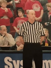 Jim Bice (right) gets ready to officiate a previous