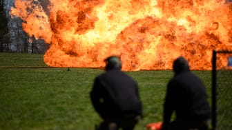 Bomb technicians detonating explosives made from readily available items at the FBI Newark division's demonstration Tuesday at the Middlesex County prosecutor's training center in Edison.