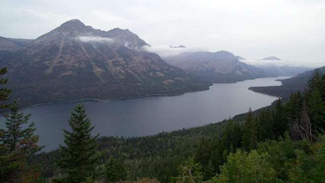 This undated image provided by the National Park Service shows a view from Goat Haunt Lookout inside Glacier National Park in Montana looking over Waterton Lake into Canada.