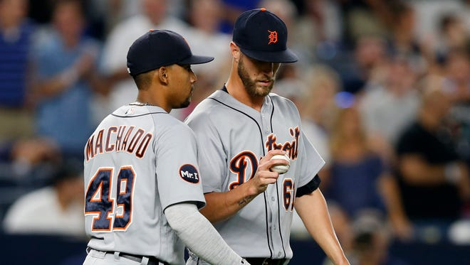 Tigers shortstop Dixon Machado talks to reliever Shane Greene after Greene threw the ball past first base on a pickoff attempt, allowing the Yankees' Jacoby Ellsbury to advance to third in the ninth inning at Yankee Stadium on Aug. 1, 2017. Greene earned the save when Clint Frazier popped out to Machado to end the game for a 4-3 Tigers win.