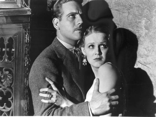 """Melvyn Douglas and Gloria Stuart in a scene from """"The Old Dark House."""""""