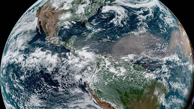 An image from June 21shows the cloud of dust associated with the Saharan Air Layer traveling into the Caribbean Sea toward the Gulf of Mexico.