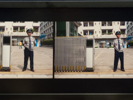 """Security Guard, Dongguan, China"" by Wing Young Huie."