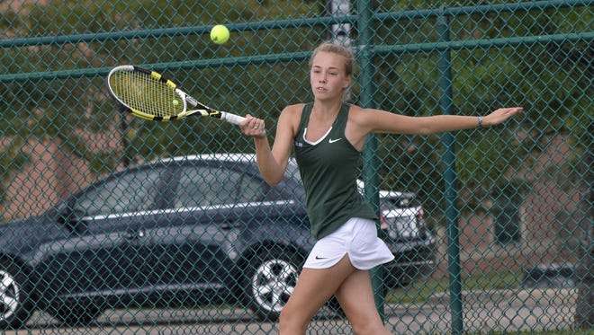 Ursuline's Gracie Estes lifts a forehand back for point at the GCTCA Coaches Classic. Sept. 14, 2017 - Geoff Blankenship for The Enquirer