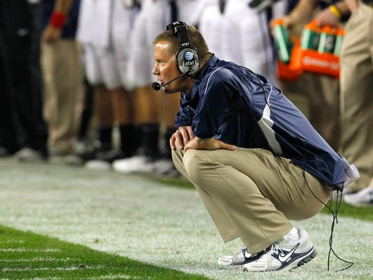 Connecticut head coach Randy Edsall watches a measurement