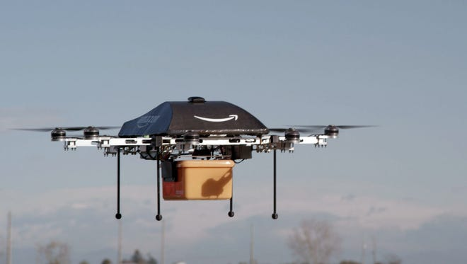 Amazon's unmanned drone delivers a package during a test run.