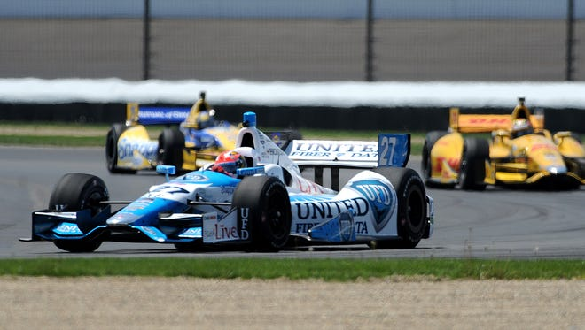 James Hinchcliffe pulled into the grass during the later stages of the Grand Prix of Indianapolis after getting hit by debris.
