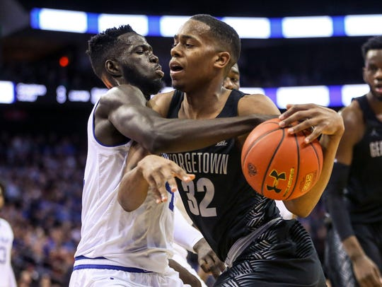 Georgetown Hoyas guard Kaleb Johnson (32) drives to