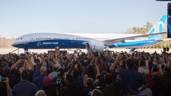 A crowd takes photos of Boeing's new 787-10 Dreamliner at its official unveiling at the jet-maker's production facility in North Charleston, S.C., on Feb. 17, 2017.