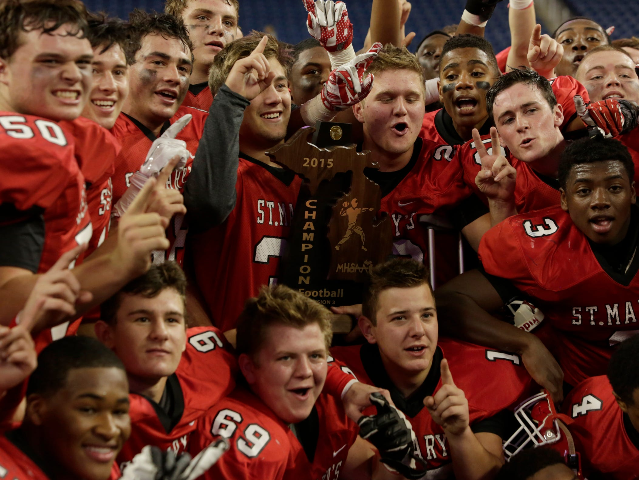 Orchard Lake St. Mary's celebrates their 29-12 victory over Chelsea in the Division 3 football title game at Ford Field on Saturday.