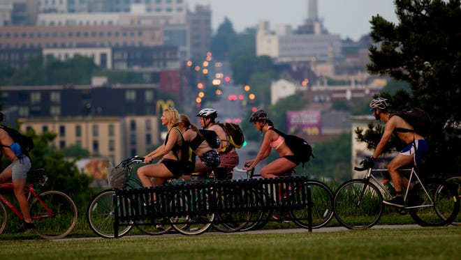 Bike riders ride down Reservoir Hill toward Riverwest during the Milwaukee Underwear Bike Ride in 2016. The 2018 is Friday night.