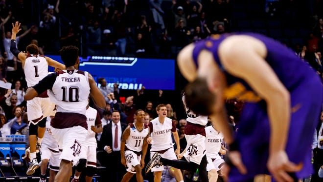 Northern Iowa Panthers forward Klint Carlson (2) reacts as Texas A&M Aggies players celebrate the victory after the game in the second round of the 2016 NCAA Tournament at Chesapeake Energy Arena.
