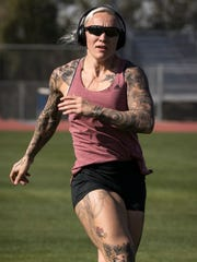 Canadian Olympic bobsled athlete Kaillie Humphries stretches during training on Jan. 30, 2018, at Paradise Valley Community College.