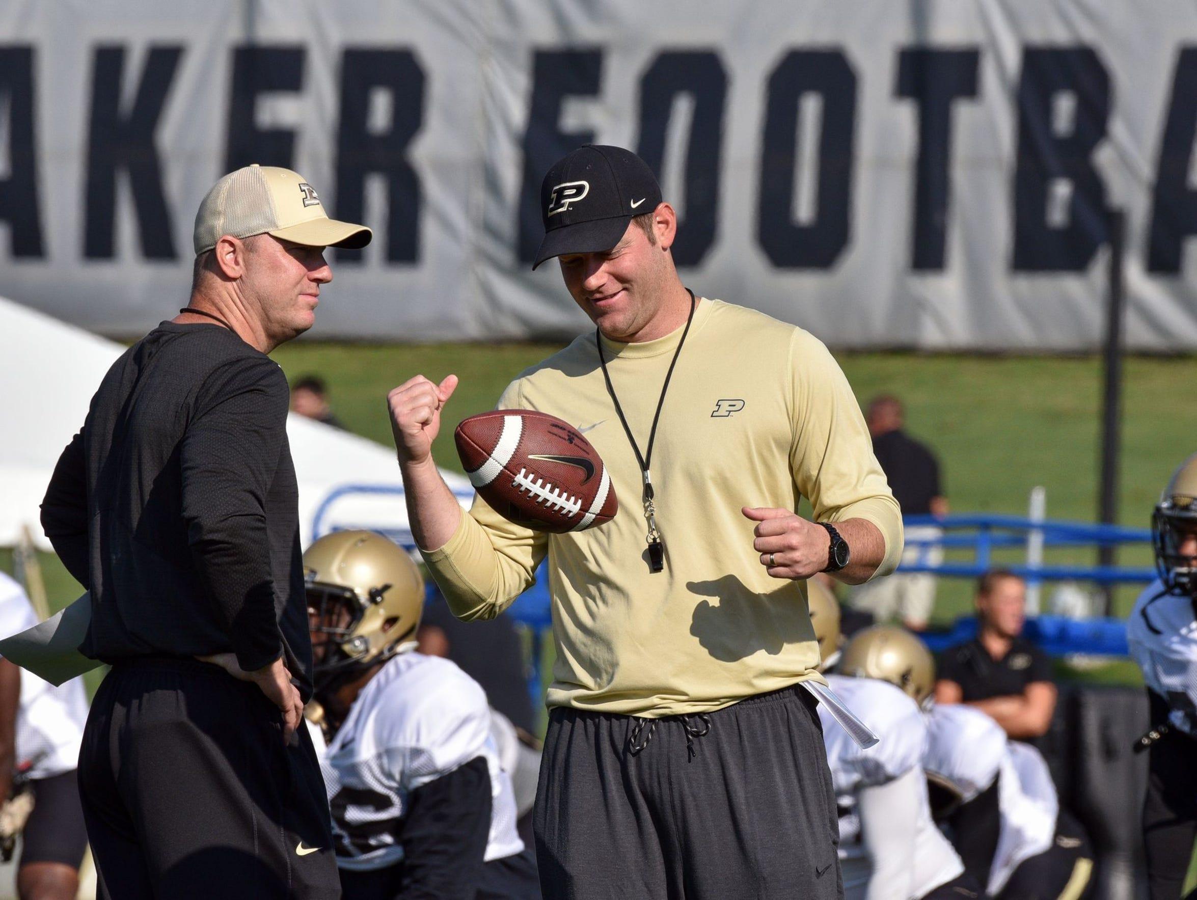Purdue head coach Jeff Brohm (left) and QB coach/co-offensive