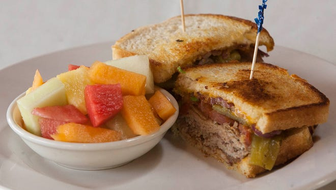 The Beefeater, a sandwich with roast beef, ortega chili, grilled red onion, tomato and cheddar cheese, is served with a fresh fruit bowl at the Soule Park Golf Course restaurant in Ojai.