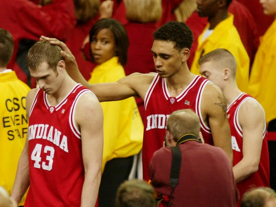 Jared Jeffries consoles Jarrad Odle after IU lost to Maryland in the 2002 NCAA Championship game in Atlanta.