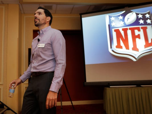 Dean Blandino, NFL vice president of officiating, begins a training session during the Annual NFL Officiating Clinic in Irving, Texas, Friday, July 18, 2014.  The NFL's 119 game officials are attending the league's officiating developmental program held at a hotel in North Texas. (AP Photo/LM Otero)