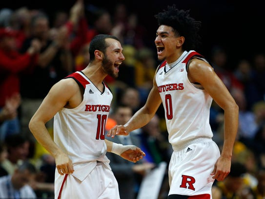 Rutgers Scarlet Knights guard Jake Dadika (10) and