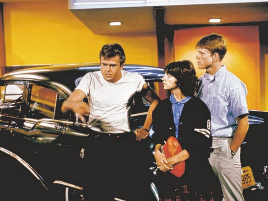 "Paul Le Mat, left to right, Cindy Williams and Ron Howard are shown in a scene from the motion picture ""American Graffiti."""