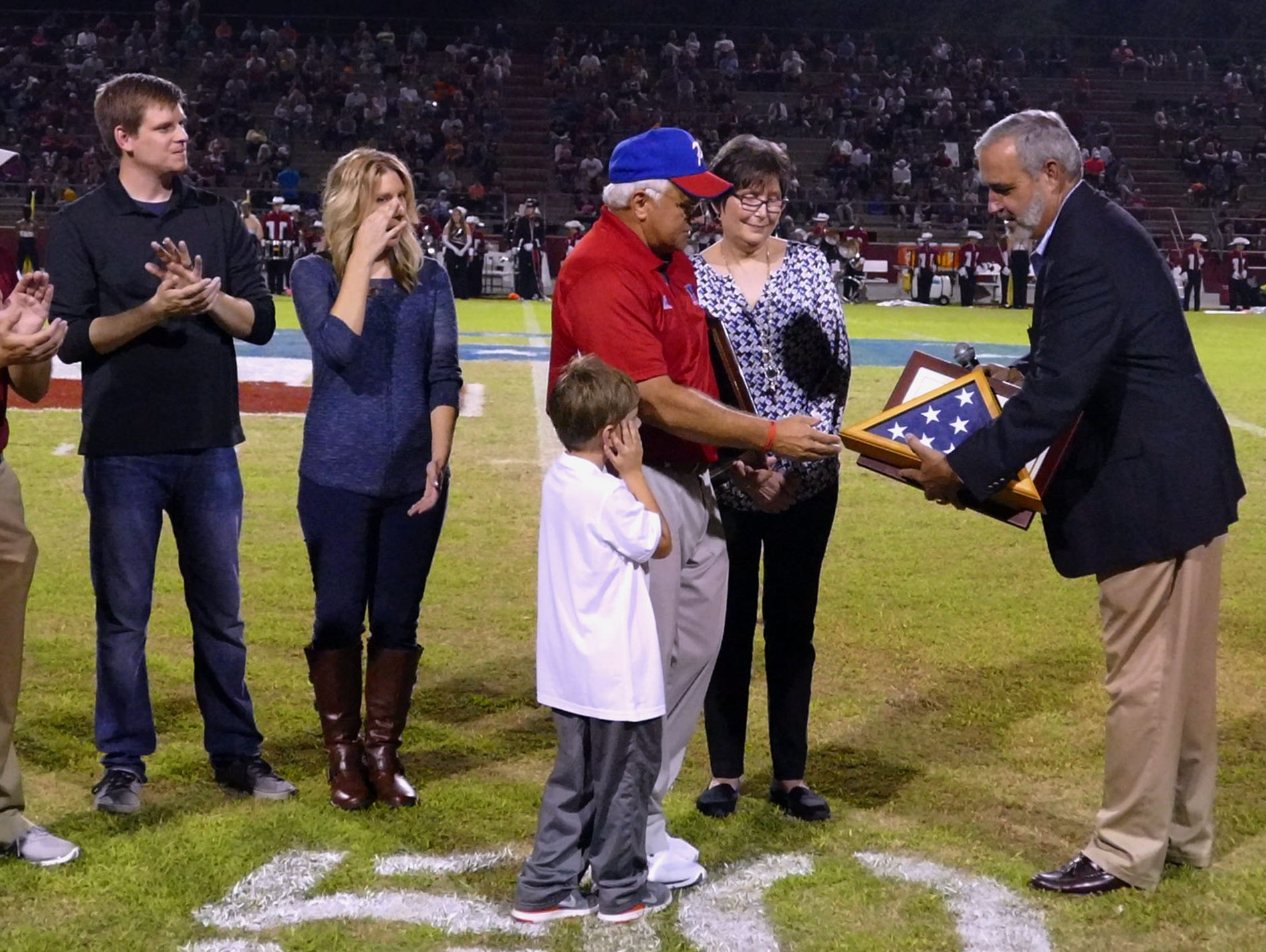 Congressman Jeff Miller, far right, was on hand to congratulate Pace Head football coach Mickey Lindsey on his years of service and upcoming retirement. To the left are members of Mickey's family including his son, Jay Lindsey, the head coach of the Tate Aggies, the team Pace was hosting Friday night. The Aggies went on to win the game 48-28.