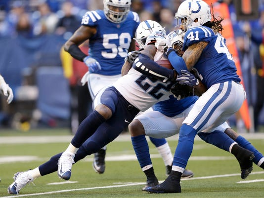 Tennessee Titans' Derrick Henry (22) is tackled by Indianapolis Colts' Matthias Farley (41) during the second half of an NFL football game, Sunday, Nov. 26, 2017, in Indianapolis. (AP Photo/AJ Mast)