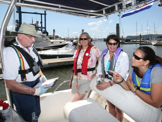 Fred Mangelsdorf of the Mid-Hudson Power Squadron instructs Sue Bordansky of Yorktown, Victoria Malora of Stanford and Noelle Gold of Dobbs Ferry on boat safety during the Practical On Water Training course at Shattemuc Yacht Club in Ossining June 7, 2014.