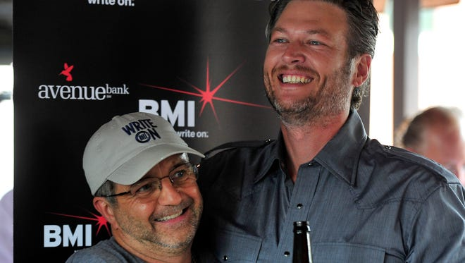 Songwriter Phil O'Donnell, left, gets a hug from Blake Shelton during a No. 1 Party at Losers Bar & Grill in Nashville.