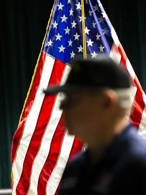 Silhouetted against the American flag, retired Army Col. Craig Ham spoke in 2019 about the importance of remembering Pearl Harbor. Two Marion schools will receive grant funding to bolster civics education.