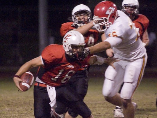 Palm Desert's Lars Hanson (right) reaches for Michael Karls of Palm Springs in this 2009 file photo.