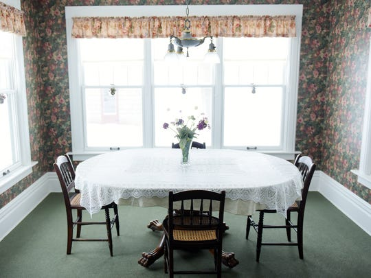 A breakfast nook near the front of the house is seen