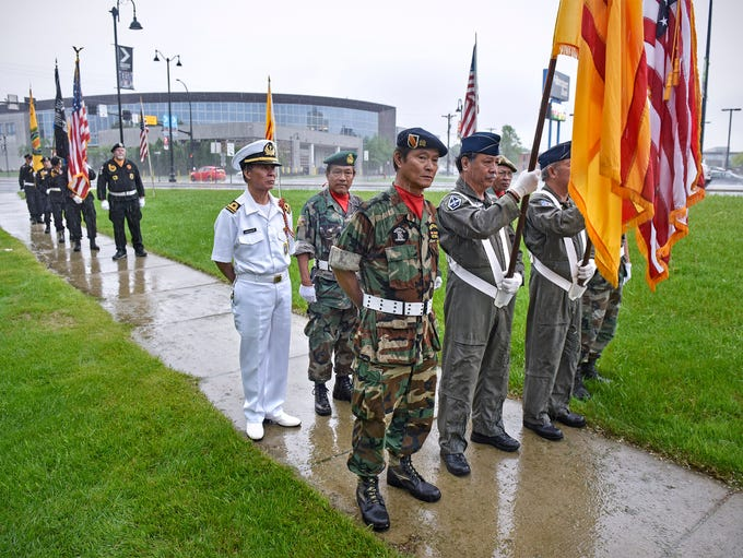 Color guard members prepare for the ceremony to begin