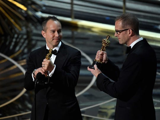 """Jonas Rivera and Pete Docter accept the Oscar for best animated feature for """"Inside Out."""""""
