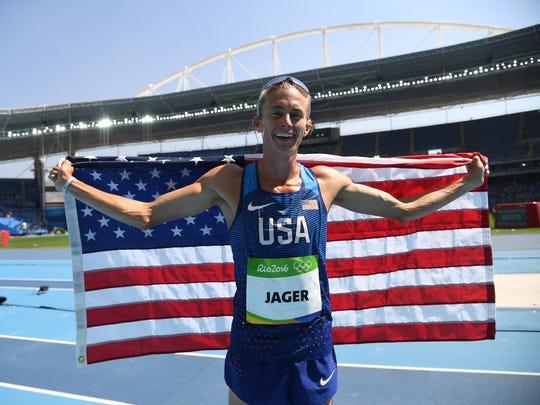 Evan Jager (USA) celebrates after placing second during the men's 3000m steeplechase final in the Rio 2016 Summer Olympic Games at Estadio Olimpico Joao Havelange.