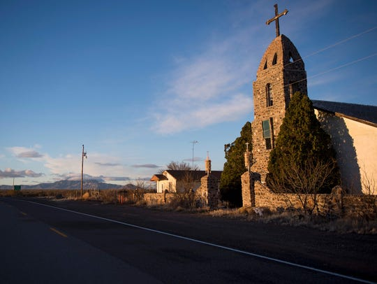 An abandoned Catholic Church stands just off the road