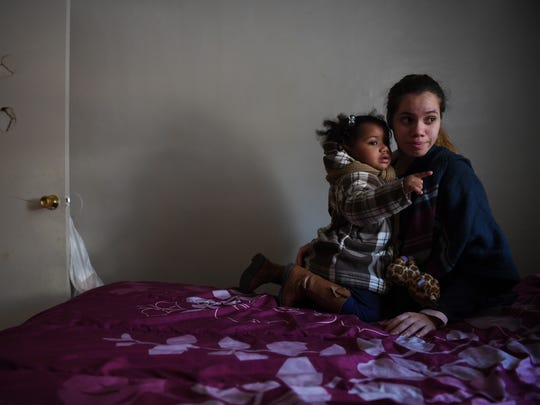 Yanira Cortes, 28 of Newark, with her daughter Brielle, 2, at their apartment at Pueblo City on Nov. 14, 2016. Pueblo City has been condemned twice Cortes and her family live in substandard conditions. At the time this photo was taken, her electricity was off. Cortes said conditions have become worse with a rat infestation.